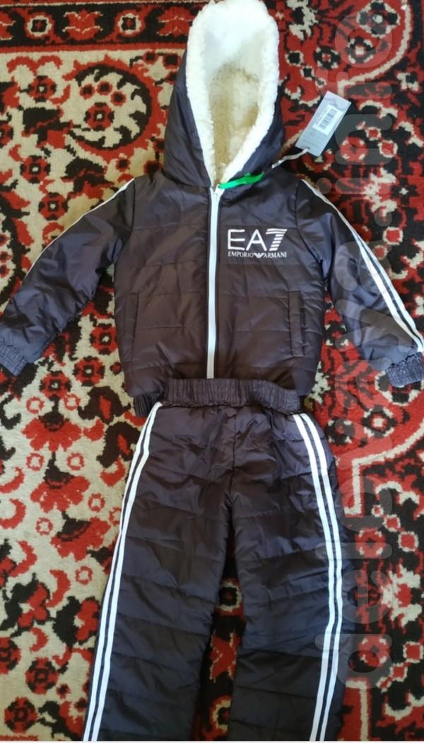 Продам за ненадобностью новый костюм размер 98 см, куртка на овчине,а