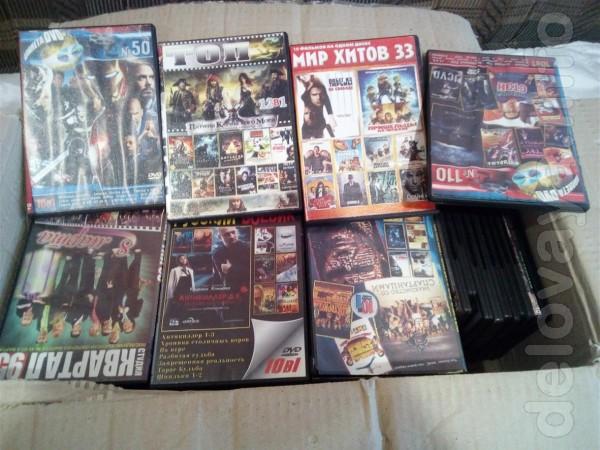 DVD диски с фильмами различной тематики в количестве 75 штук. По 3 гр