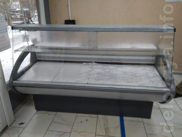 Продам холодильную витрину среднетемпературную 1,8м РОСС 10 000 грн Г
