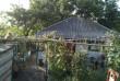 Продается домик  с  печным отоплением р-н Детского мира, летняя кухня